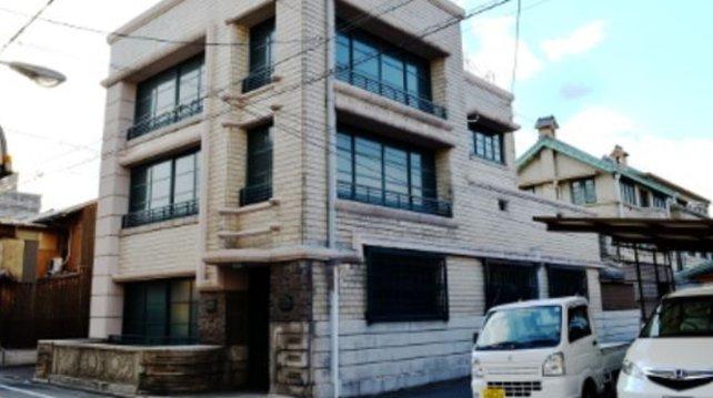 1933 ist Nintendos neuer Unternehmenssitz eines der wenigen japanischen Gebäude aus Stein und Metall.
