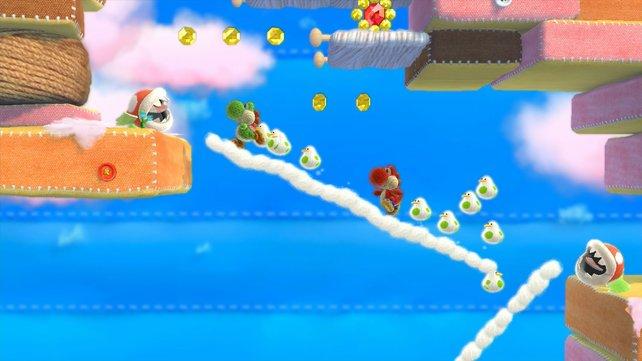 Zwei Spieler agieren am selben Bildschirm als grüner und roter Yoshi.