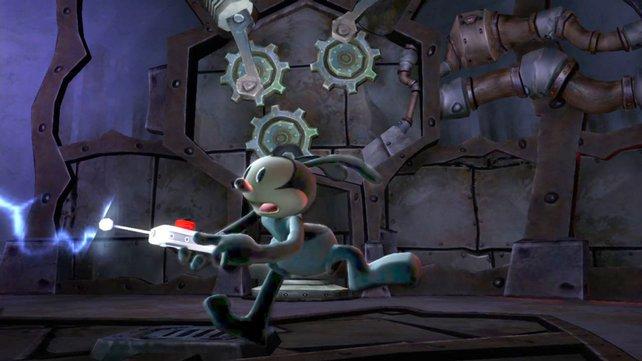 Oswald aktiviert mit seiner Fernbedienung eine Maschine.