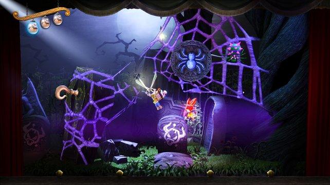 Mit der magischen Schere zertrennt ihr Spinnennetze und könnt so große Höhenunterschiede überwinden.