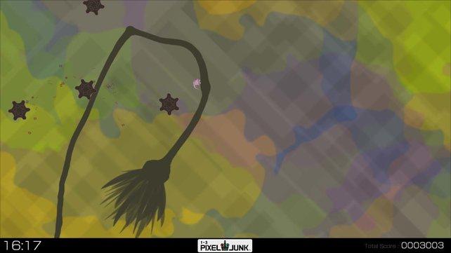 Der Grimp hält sich an einer Pflanze fest.