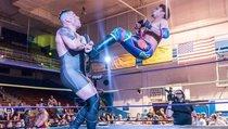 Wrestler zockt während der Schaukämpfe
