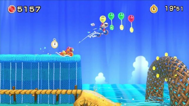 Mario und Samus in einem Excitebike-Verschnitt? Keineswegs! Zwei amiiboisierte Yoshis im Motorradaufzug jagen einträchtig Juwelen und Grinseblumen nach.