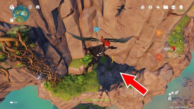 Der rote Pfeil auf dem Bild zeigt euch den Eingang in der Felswand.