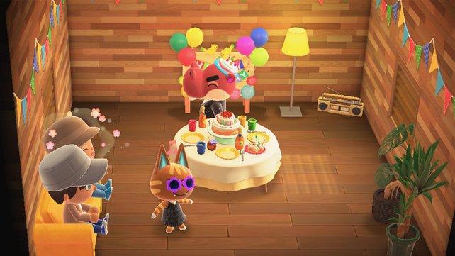 Die Geburtstagsfeier in Animal Crossing: New Horizons findet in einem festlich dekorierten Raum statt.