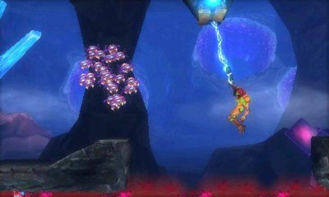 """Den Grapple Beam hat Samus erstmals bei Super Metroid auf dem SNES benutzt. Damals hieß er noch """"Grappling Beam""""."""