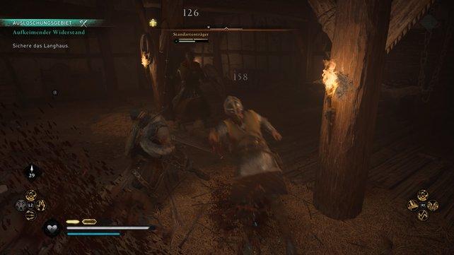 Im Inneren des Langhauses müsst ihr euch mehreren Gegnern stellen. Dank Sigurds und Basims Unterstützing sind diese aber keine Heruasforderung.