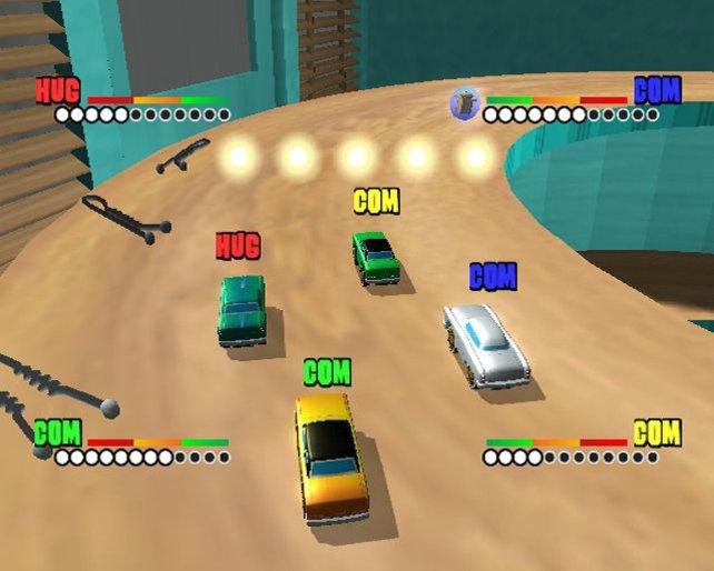 4 Autos fahren in eine Kurve.Vor ihnen erscheinen gerade 5 Power-Ups.