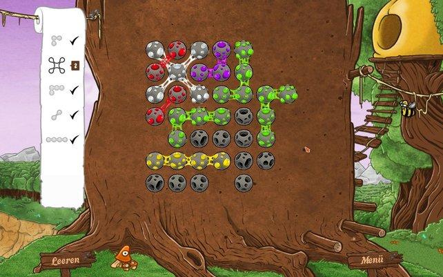 Der Spieler zeichnet eine vorgegebene Zahl von Mustern in die grauen Schneckenbälle ein.