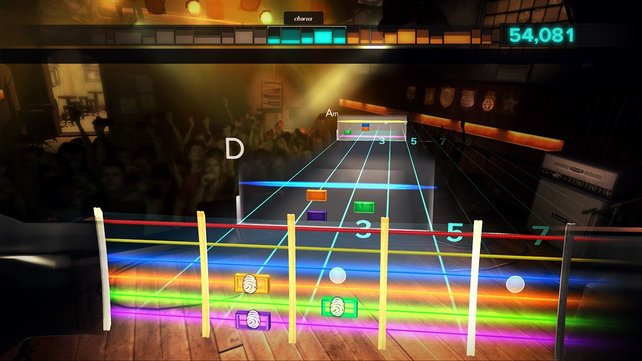 Das Spiel erinnert an Guitar Hero. Doch anstatt Plastiktasten, zupft ihr echte Gitarrensaiten.