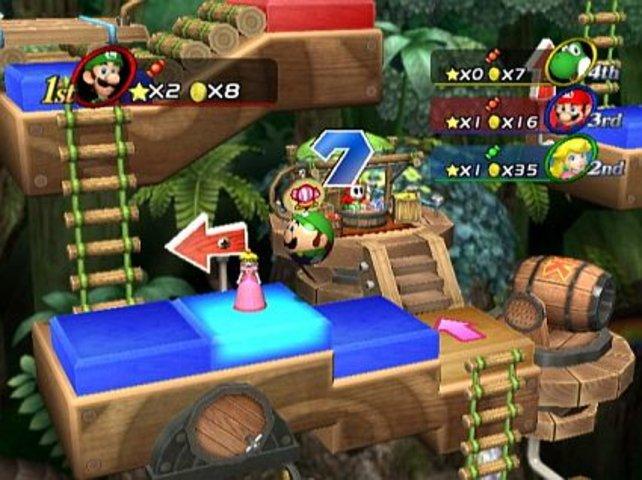 Luigi überrollt gleich Peach auf dem Spielbrett