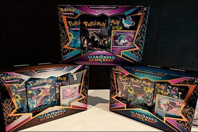 Das Set der Edition Glänzendes Schicksal kommt in einer nagelneuen Pin-Box!
