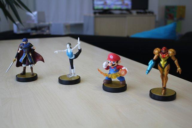 """Marth, die """"Wii Fit""""-Trainerin, Mario und Samus Aran als Amiibos."""